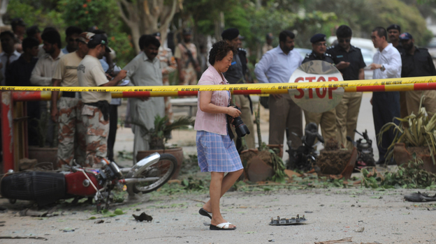 China is planning to increase investments in Pakistan, and some Pakistanis feel China is trying to become a new colonial power. Amid these tensions, a bomb went off near the Chinese Consulate in Karachi, Pakistan, on July 23. The blast injured two people. (AFP/Getty Images)