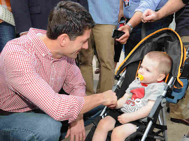 Republican vice presidential candidate Paul Ryan greets a young boy during a campagin stop at the Des Moines Register Soap Box at the Iowa State Fair August 13, 2012, in Des Moines, Iowa.