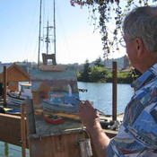 A local artist paints the scene at the Port of Toledo's Wooden Boat Show in August 2011.