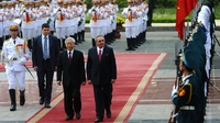 Cuba's President Raul Castro and Vietnamese Communist Party Secretary General Nguyen Phu Trong review an honor guard during an official welcoming ceremony at the presidential palace in Hanoi in July. The Cuban leader flew in from China for the second leg of his Asian tour to Cuba's two Asian communist allies.