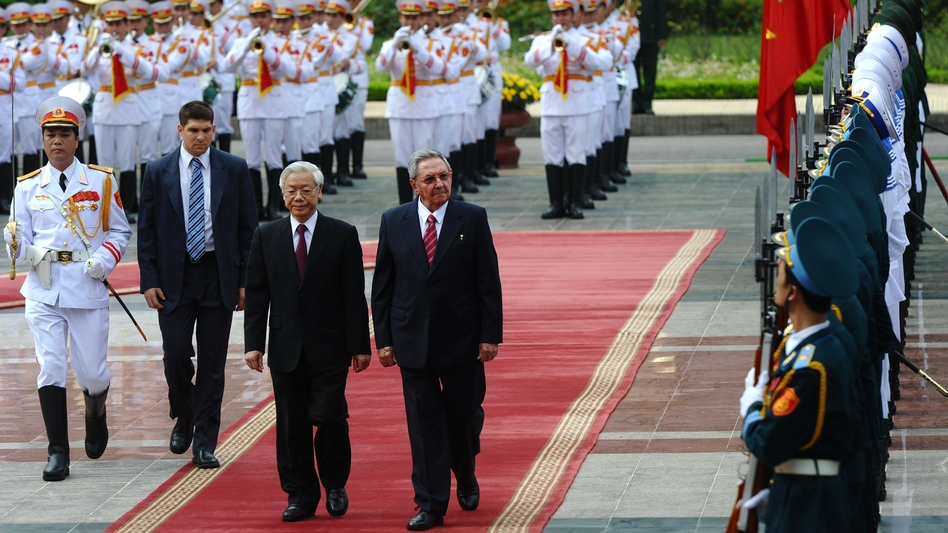 Cuba's President Raul Castro and Vietnamese Communist Party Secretary General Nguyen Phu Trong review an honor guard during an official welcoming ceremony at the presidential palace in Hanoi in July. The Cuban leader flew in from China for the second leg of his Asian tour to Cuba's two Asian communist allies. (AFP/Getty Images)