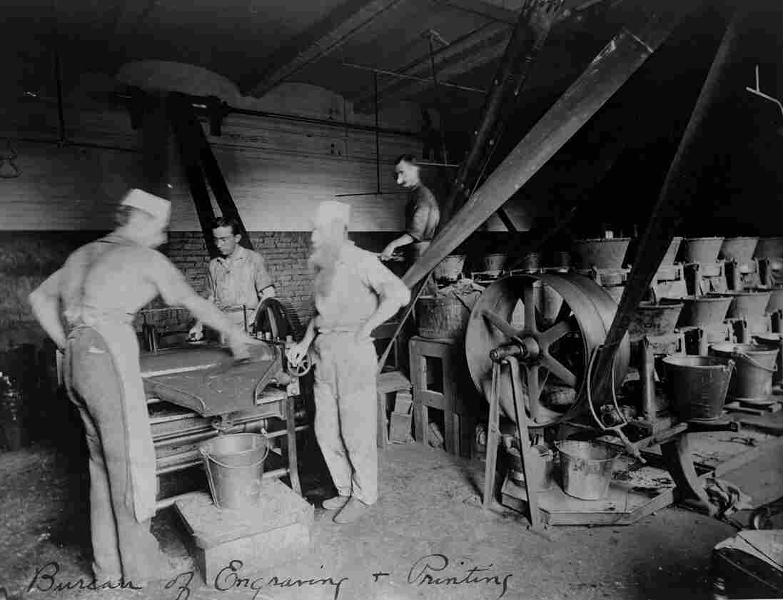 Workers grind a non-removable, green ink into the right viscosity for the presses, circa 1890. Green became the standard color because it made bills harder to alter or counterfeit.