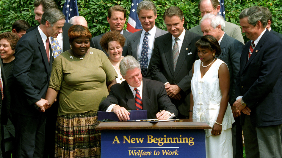 President Clinton signs the welfare reform law on Aug. 22, 1996.