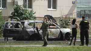Police examine the site of a car bomb in the Russian city of Kazan on July 19. Ildus Faizov, the mufti of Tatarstan and the top Islamic leader in the region, was wounded in the explosion, while his deputy, Valiulla Yakupov, was shot dead in a separate incident on the same day.