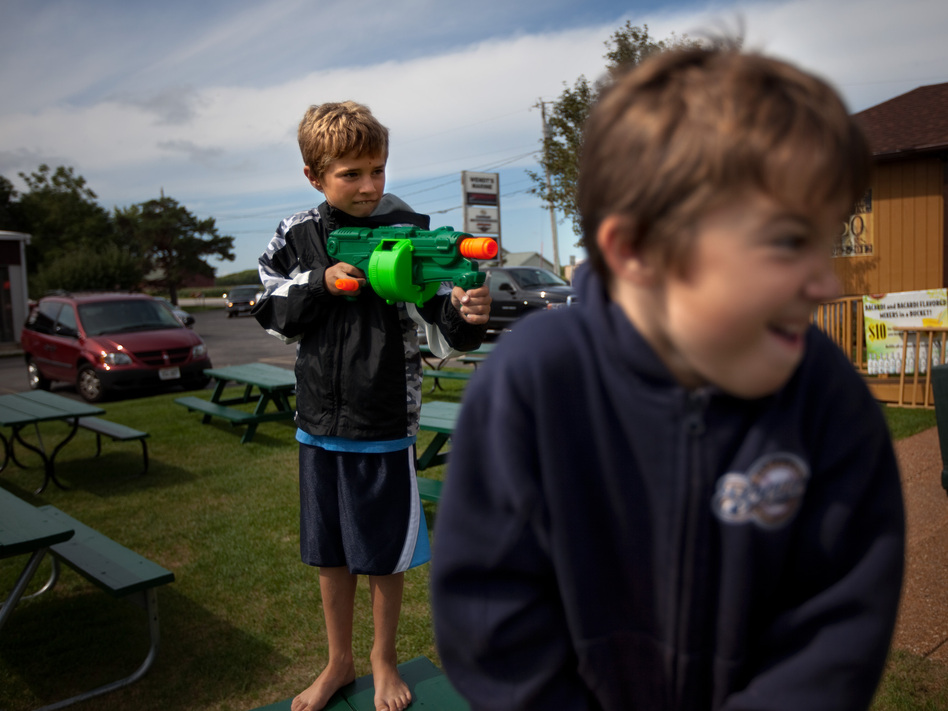 Wendt's grandchildren, Zach, 9, and Sawyer, 6, play with Nerf guns outside the family restaurant. (NPR)