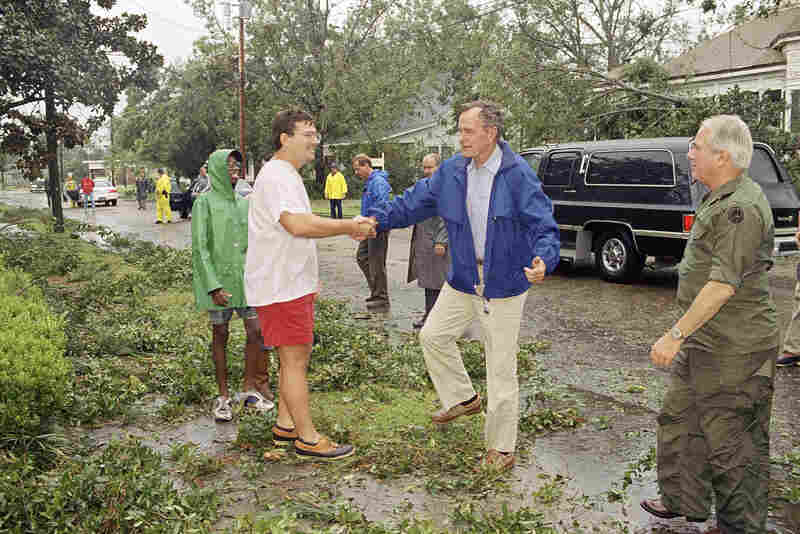 President George H.W. Bush talks to Dave Cavalier during a visit to view storm damage in New Iberia, La.