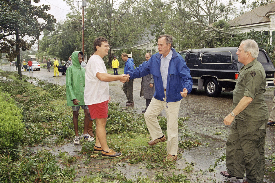 President George H.W. Bush talks to Dave Cavalier during a visit to view storm damage in New Iberia, La.  (AP)