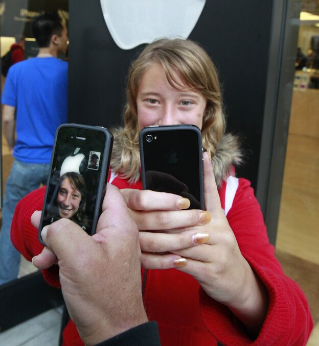 Emilie Weideman and her father, Marc Weideman, of Fremont, Calif., use FaceTime after purchasing the new device in June 2010.
