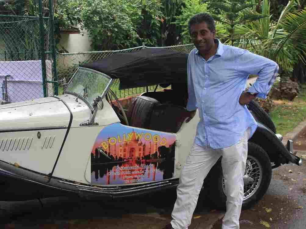 Cuba has tight advertising restrictions, so Cedric Fernando uses his British-made 1955 MG convertible to spread the word about his Indian restaurant, Bollywood, in Havana.