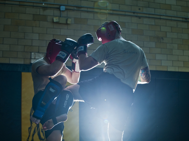Student instructors take turns practicing maneuvers during a sparring session at the U.S. Army Combatives school at Fort Benning.