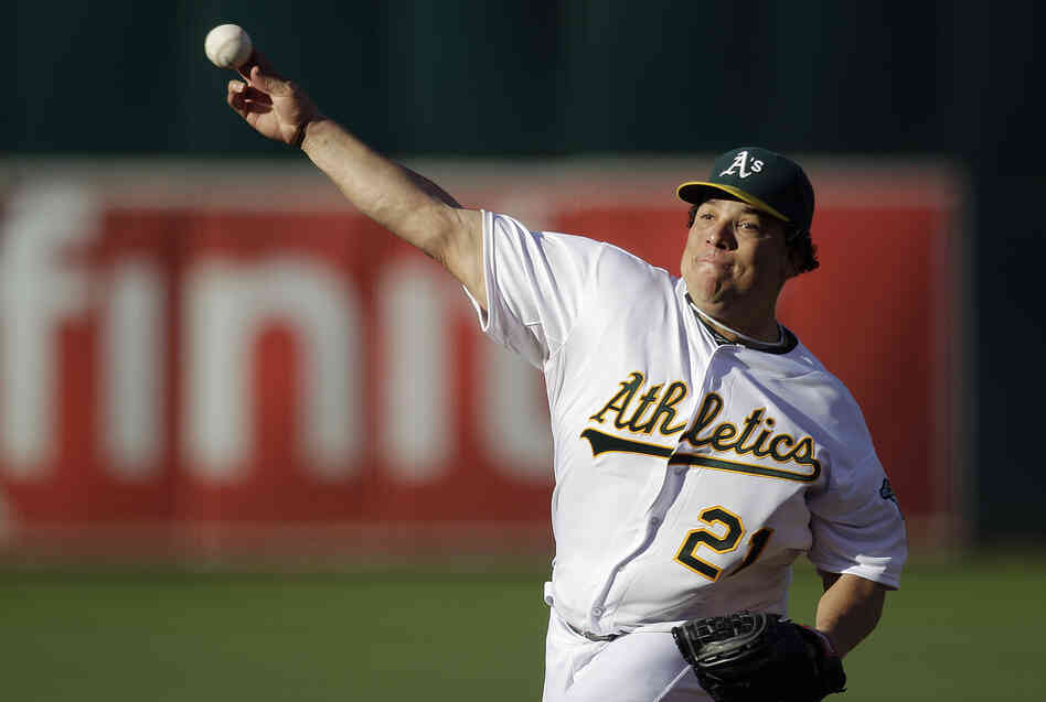Oakland Athletics pitcher Bartolo Colon works against the Cleveland Indians in the first inning of a ba
