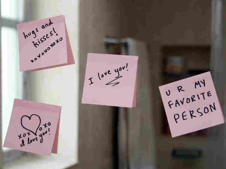 Love notes stuck on a mirror.