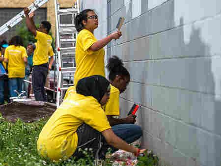 Preparing a wall for a mural.