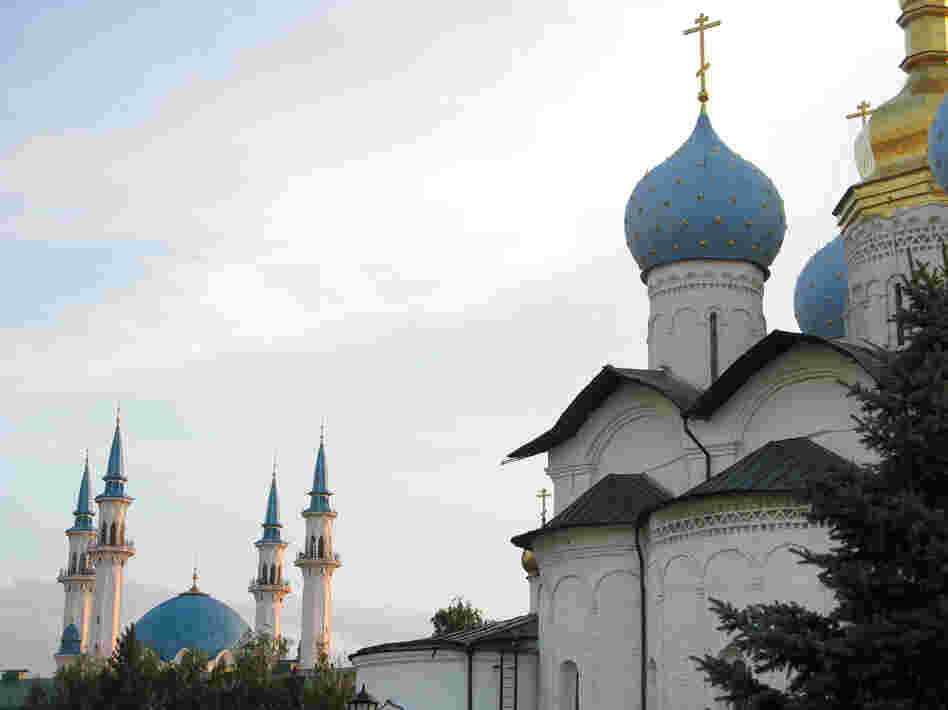 The domes of a Russian Orthodox church (right) share the skyline of Kazan, Tatarstan's capital, with the minarets of a Muslim mosque, a reminder of the city's history of peaceful coexistence between Christians and Muslims.