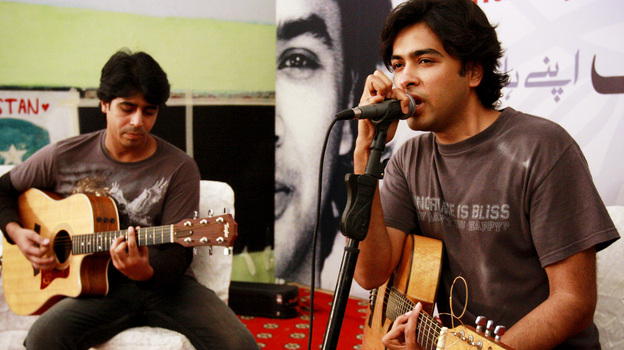 Pakistani pop singer Shehzad Roy (right) sings for teenage prisoners at a prison in Karachi, Pakistan, in 2008. Known originally for fluffy pop songs, Roy's music has taken a harder, more political edge, protesting injustice in Pakistan. (AP)