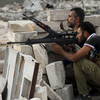 The daily fighting in Syria included this gun battle Wednesday involving rebels in the northern city of Aleppo. Still, the rival sides recently worked out a prisoner swap in which two women were freed from state custody, while the rebels released seven pro-government fighters.