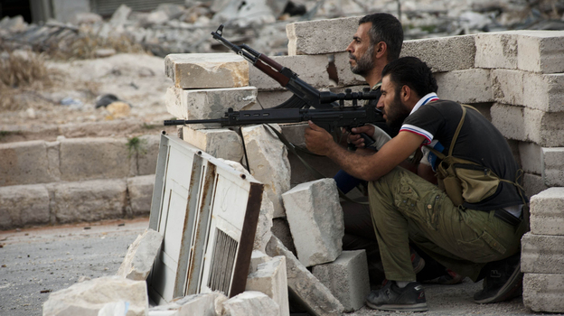 The daily fighting in Syria included this gun battle Wednesday involving rebels in the northern city of Aleppo. Still, the rival sides recently worked out a prisoner swap in which two women were freed from state custody, while the rebels released seven pro-government fighters. (AFP/Getty Images)