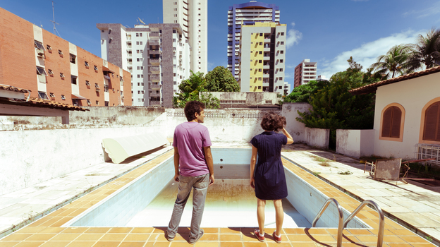 Joao (Gustavo Jahn) and Sofia (Irma Brown) are among the inhabitants of the Recife, Brazil, street where Neighboring Sounds takes place. (Cinema Guild)