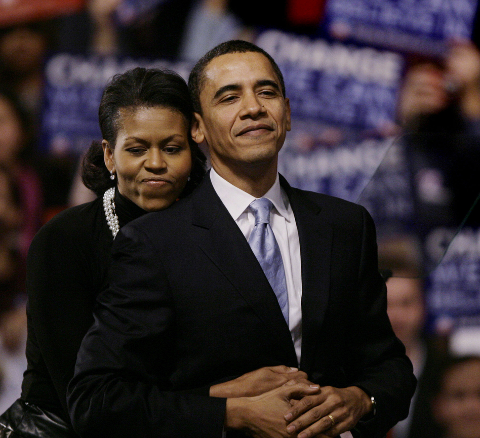 The Obamas on Jan. 8, 2008, at then-Sen. Barack Obama's primary night rally in Nashua, N.H.