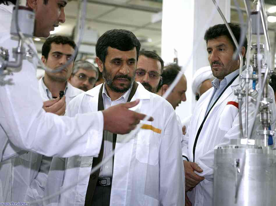 Iranian President Mahmoud Ahmadinejad (center) visits the Natanz Uranium Enrichment Facility in April 2008. Israel and the U.S. targeted the facility in 2009 with the Stuxnet cyberattack.