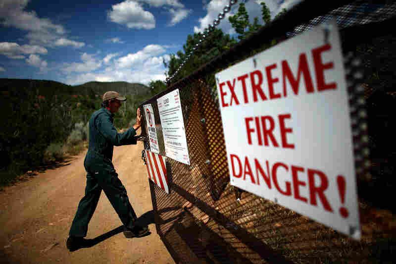 Bill Armstrong of the U.S. Forest Service opens the security gate at the Santa Fe watershed, in New Mexico's Sangre de Cristo mountains.