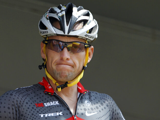 Lance Armstrong grimaces prior to the start of the third stage of the Tour de France cycling race in Wanze, Belgium, on July 6, 2010. Armstrong said Thursday he is finished fighting charges from the U.S. Anti-Doping Agency t