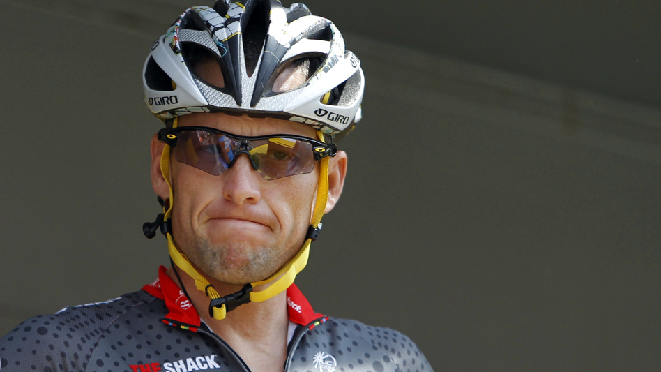 Lance Armstrong grimaces prior to the start of the third stage of the Tour de France cycling race in Wanze, Belgium, on July 6, 2010. Armstrong said Thursday he is finished fighting charges from the U.S. Anti-Doping Agency that he used performance-enhancing drugs during his unprecedented cycling career. (AP)
