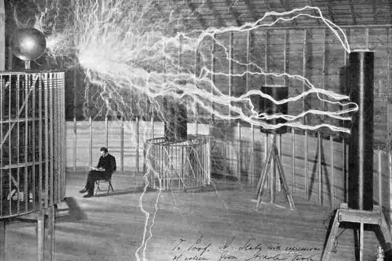 At a laboratory in Colorado Springs, Colo., Nicola Tesla worked with a magnifying transmitter, a device he used to conduct experiments in sending electricity without wires. This image, from around 1900, is a double exposure; the man sitting in the chair wasn't present when the electricity was discharged.