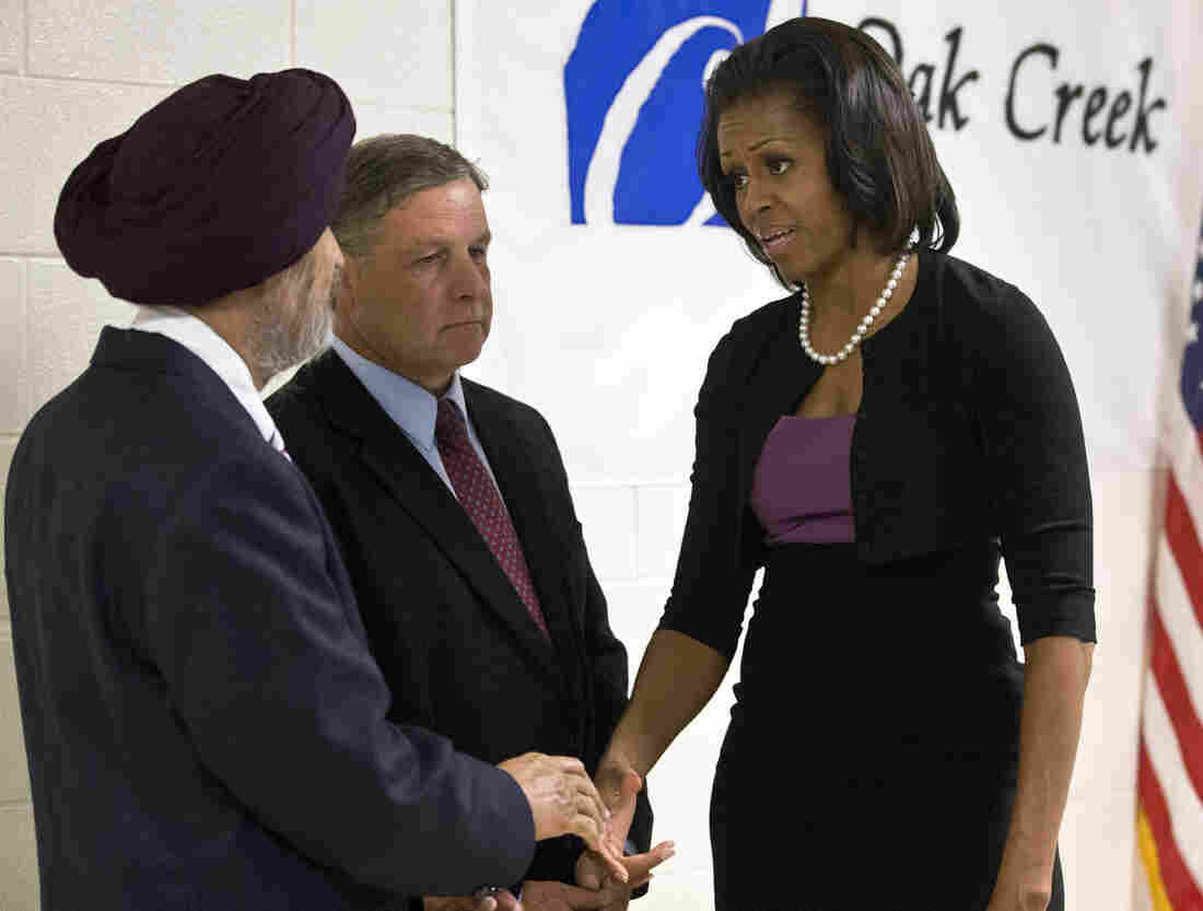 First lady Michelle Obama greets Sikh temple secretary of the board of trustees Kulwant Singh Dhaliwal, left, and Oak Creek, Wis.