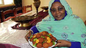 The reporter's mother, Nawal Elbager, of Khartoum, Sudan, shows off her falafel.