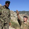 """Spc. Ben Purvis (center) helps train Afghan troops on how to use mortars in the eastern province of Kunar in June. The top U.S. commander in Afghanistan, Gen. John Allen, points to several factors in the rise of """"insider attacks"""" on American forces. He says relations between U.S. and Afghan troops are good overall."""