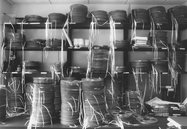 Mountains of exhausted-looking audio tapes, replete with white leader tapes to help engineers thread them onto tape recorders.