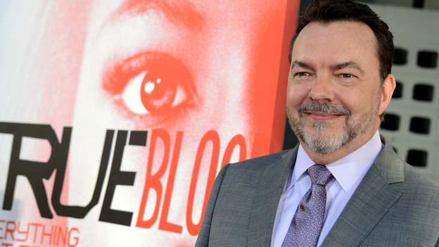 Writer Alan Ball arrives at the premiere of the fifth season of HBO's True Blood in May. Ball is leaving the series at the end of this season. (Getty Images)