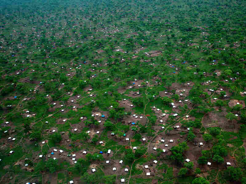 White tents scatter across the Yida refugee camp along northern border of South Sudan on June 29. The international aid community is struggling to provide food and medical supplies to the families after heavy rains blocked roads to the camp.