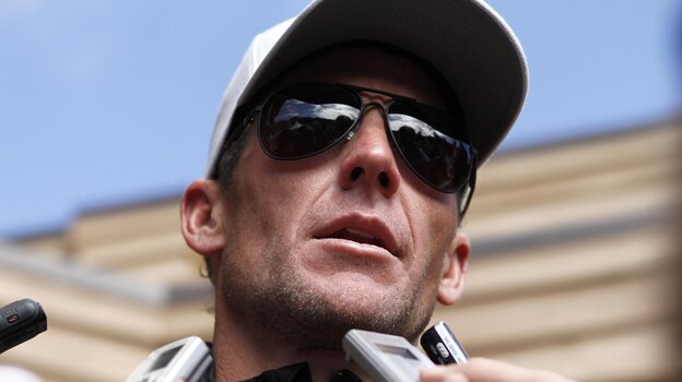Lance Armstrong speaks to the media after the February 2011 Xterra Nationals triathlon. On Friday, the cyclist said he would no longer fight doping allegations.