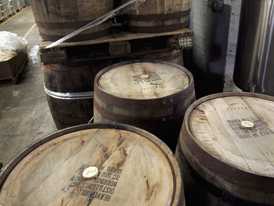 Used bourbon barrels like these at the Goose Island Brewery in Chicago are finding new life by bringing distinctive flavor to beer, cocktails and hot sauce. (Getty Images)