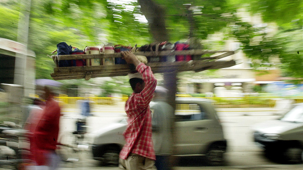 Dabba wallahs carry lunchboxes to offices in Indian cities. But the old tradition is changing with modern times. (AP)