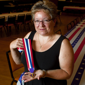 Retired Army Major Michelle Dyarman holds the Purple Heart medal she was awarded after suffering a severe concussion from an IED in Baghdad in 2005.