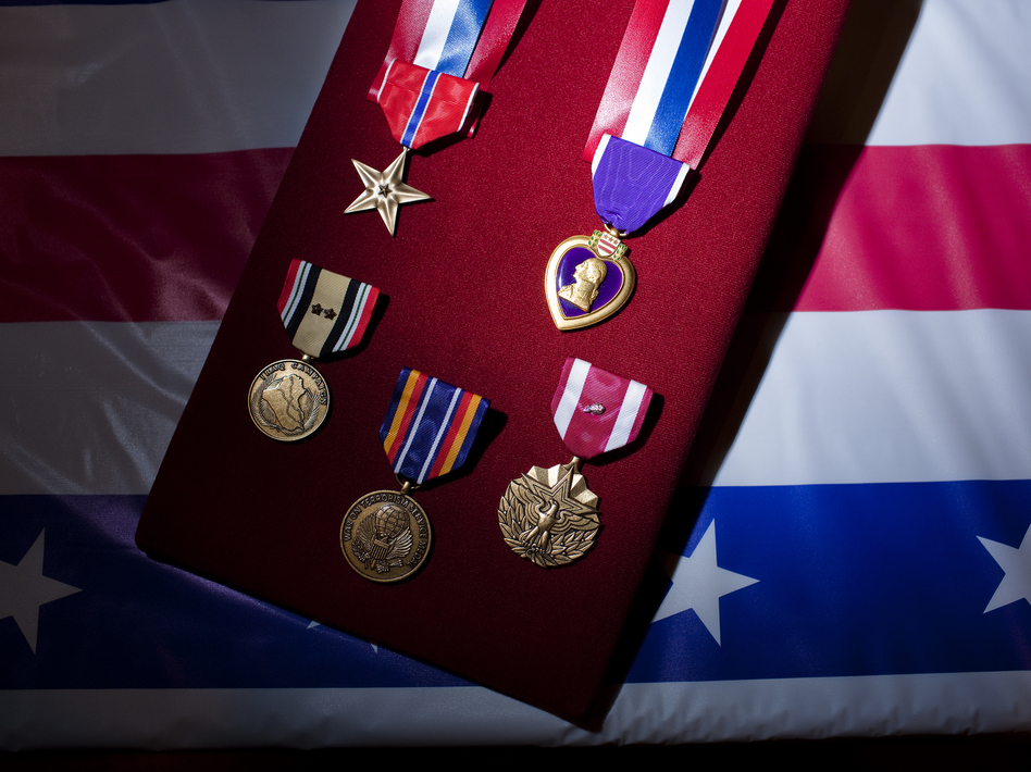 Dyarman's Army medals include a Purple Heart, Bronze Star and a service award for more than 26 years in the Army. (Robb Hill for NPR)