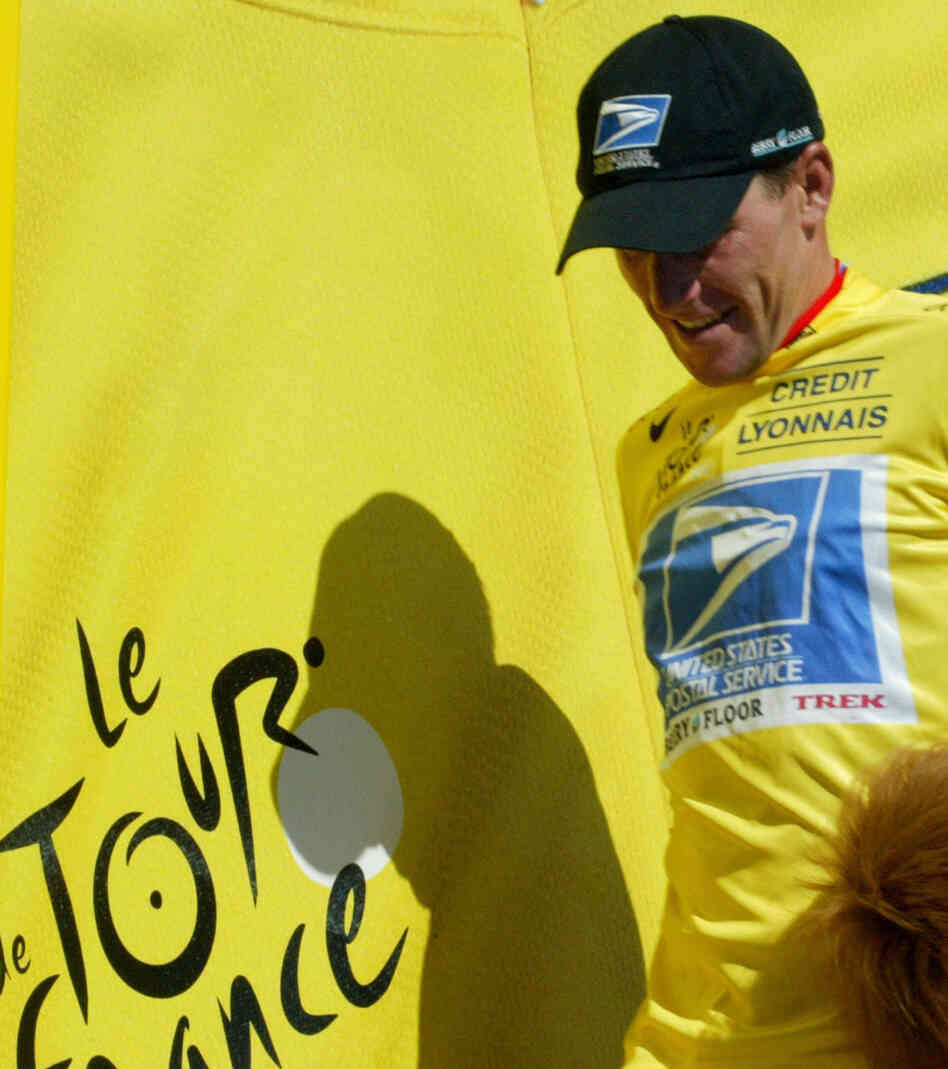 Lance Armstrong, wearing the yellow jersey that identifies the leader in the Tour de France, during the race in 2003. He won that year and six other times.