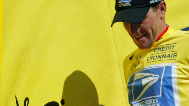 Lance Armstrong, wearing the yellow jersey that identifies the leader in the Tour de France, during the race in 2003. He won that year and six other times. (AFP/Getty Images)