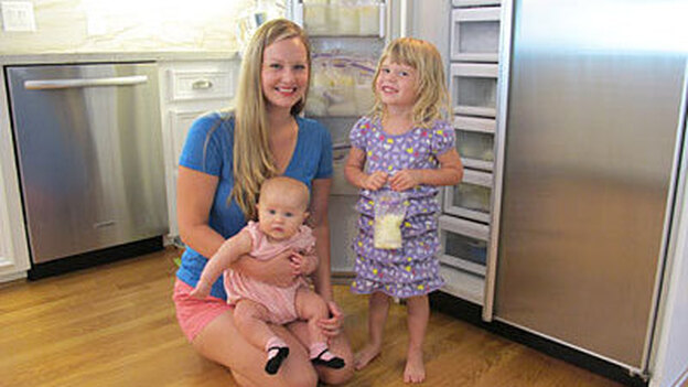 Ashley Beecher, 29, and her daughters Annie (on lap) and Charlie. After feeding Annie, Beecher donates her extra supply to the human milk bank at Texas Children's Hospital. (KUHF)