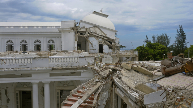 A view of the collapsed cupola of the National Palace is seen in Port-au-Prince on Aug. 13. The palace, which was destroyed in the 2010 earthquake that killed an estimated 200,000 people, was supposed to be demolished, but the plans have been put on hold. (Courtesy of Reuters)