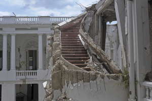 """A ruined staircase is seen in the collapsed National Palace. Parker described it as """"a staircase of grandeur."""""""