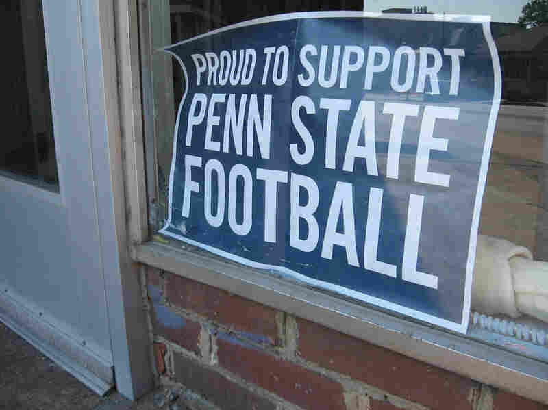 Signs on display around town are designed to show support for Penn State's football team as a new season begins.