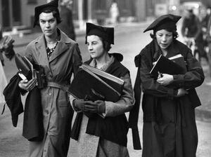 In this photo from 1938 undergraduates of Oxford University walk to lectures, well equipped with books.