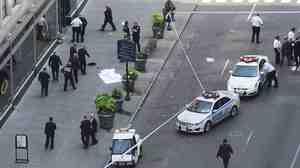 Police investigate a shooting at the Empire State Building in New York on Friday.