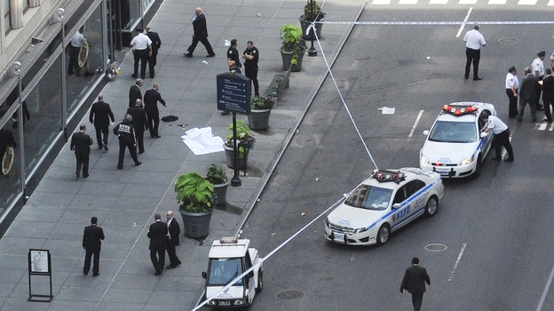 Police investigate a shooting at the Empire State Building in New York on Friday. (AP)