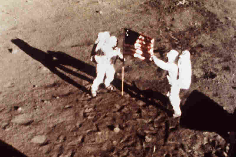 On July 20, 1969, Apollo 11 astronauts Armstrong and Aldrin, the first men to land on the moon, plant the U.S. flag on the lunar surface.