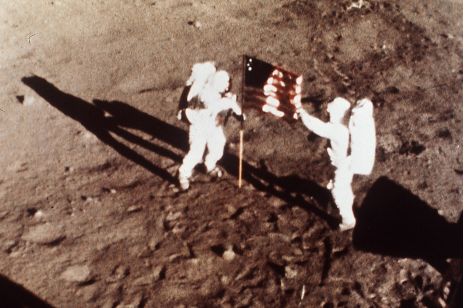 On July 20, 1969, Apollo 11 astronauts Armstrong and Aldrin, the first men to land on the moon, plant the U.S. flag on the lunar surface. (NASA)
